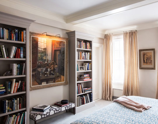 loft bedroom with stunning bookcases