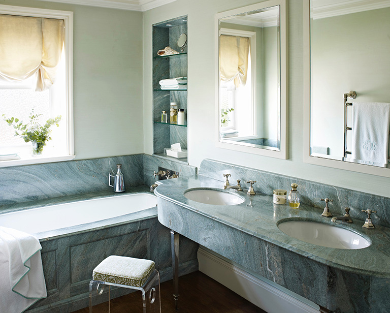 blue stonework in bathroom with dual sinks
